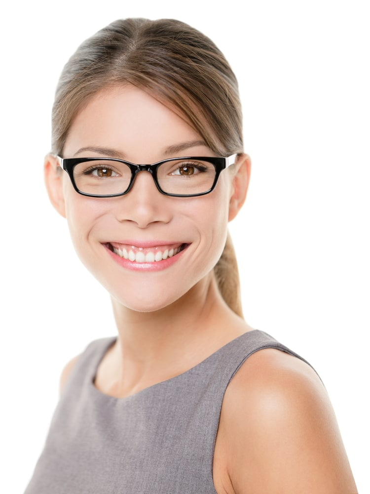 Glasses eyewear spectacles woman happy looking at camera with big smile. Close up portrait of female business woman model face isolated on white background. Mixed race Asian Caucasian businesswoman.