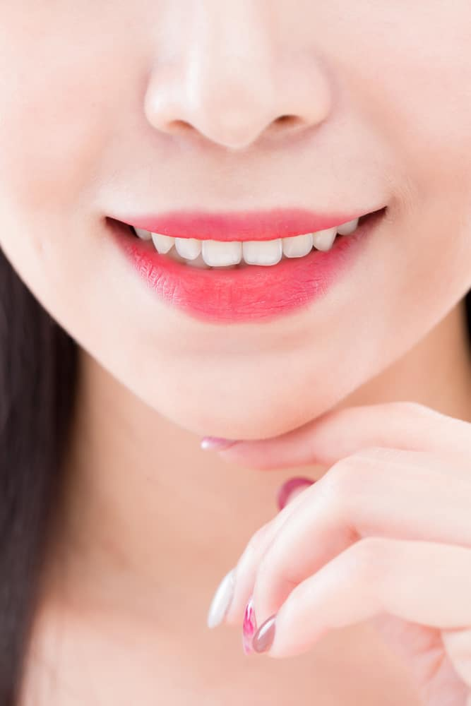 close up of beauty asia woman tooth