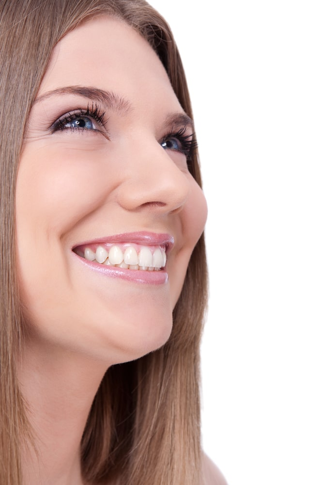 young woman with beautiful healthy teeth smiling